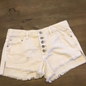 Free people cream colored jean shorts
